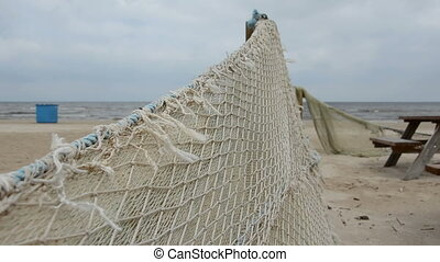 retro fishing nets on summer beach - retro fishing nets on...