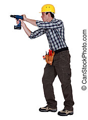 Man drilling into wall