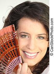 Portrait of woman with fan