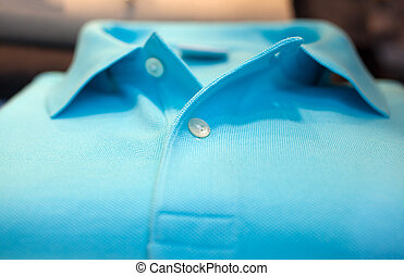 Shirt polo - Photo of cyan Shirt poloin a clothes shop