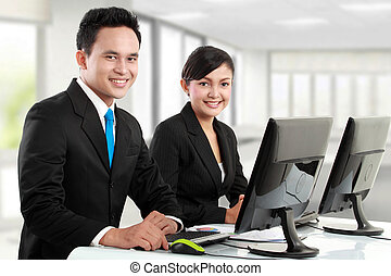 office worker working - happy woman and man office worker...