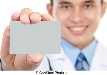 Young doctor holding business blank card