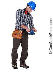 Man using sander