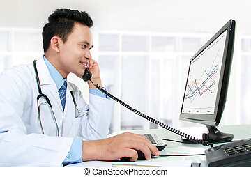 doctor working with his computer - portrait of medical...