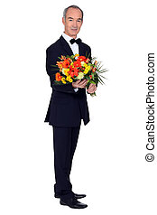 elegant senior man with a flowers bouquet