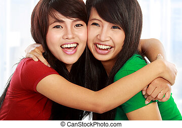 best friend - close up portrait of attractive two best...