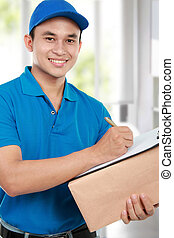 delivery man - smiling delivery man in blue uniform with...