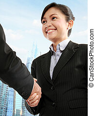 business woman shaking hands - Successful young business...