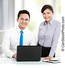 office workers - Business man and woman working together in...