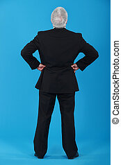 back view of senior man in a suit