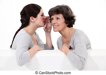 Woman telling her mother a secret