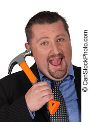Businessman putting a hammer to his head