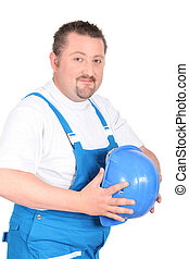 Portly builder holding a hardhat in front of his stomach