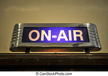ON-AIR sign is on now - An old ON-AIR sign glows on above a...
