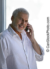 Middle-aged man taking a call