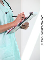 Female nurse holding clipboard and pen