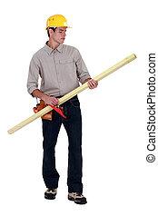 Man using wood plane