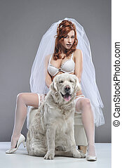Red beautiful luxury woman in underwear with dog