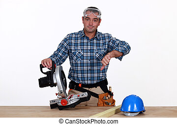 Thumbs down from a man with a circular saw