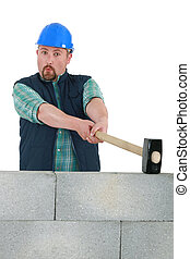 Builder with a sledgehammer