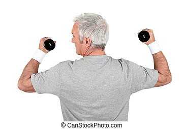 Grey-haired man doing weights