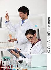 male and female laboratory technicians