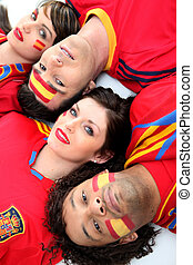A group of friends supporting the Spanish football team