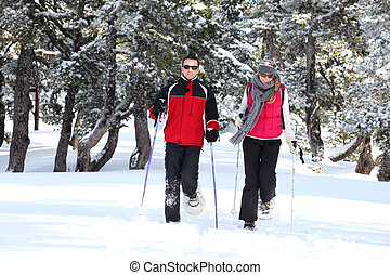 Couple walking in snowshoes