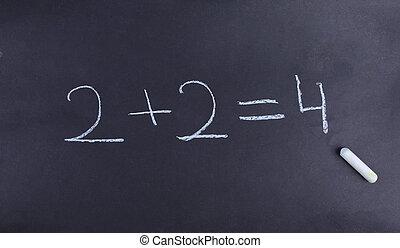basic math equation on a chalkboar