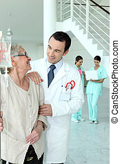 doctor with senior woman in hospital