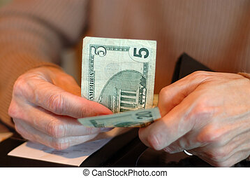 Paying The Bill With Twenty Five Dollars - Male hands...
