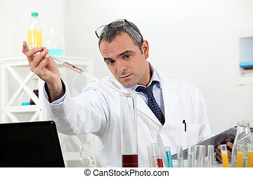 biologist with test tubes