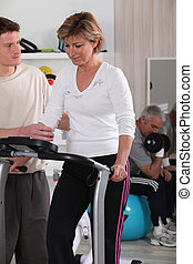 Woman with a coach in the gym