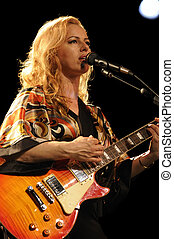 female guitarist playing in lve concert - female lead...