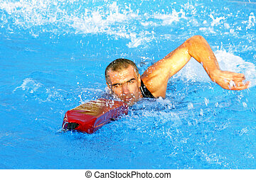 Life guard - Athletic lifeguard in rescue swimming