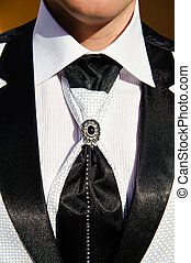 Wedding suit detail - Close up of groomsman wearing Tuxedo