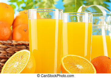Composition with two glasses of orange juice and fruits