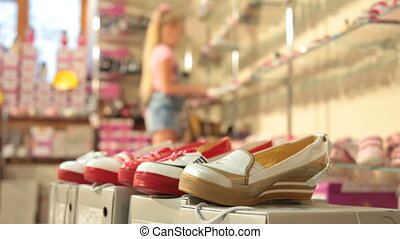 Child Choosing Footwear