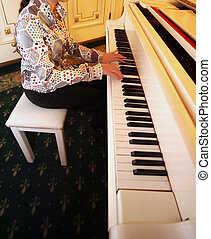 Piano - Woman playing the white piano in an interior