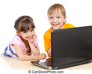happy children boy and girl using a laptop