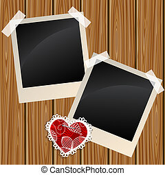 Blank photos on a wooden wall - Blank instant photo frames...