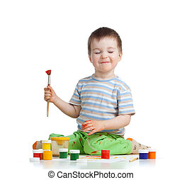 happy child boy with paints