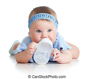 adorable child drinking from bottle 8 months old girl -...