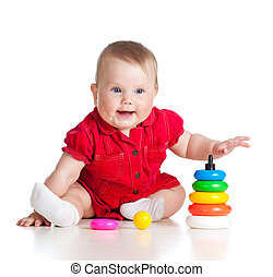baby girl playing with colourful toy isolated on white backgroun