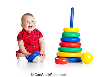 baby girl playing with big toy isolated on white background...