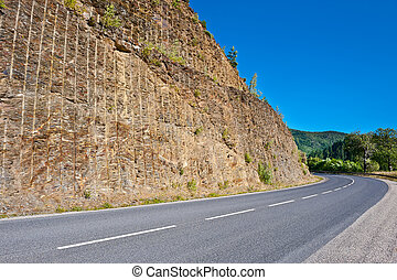 Rock above Road