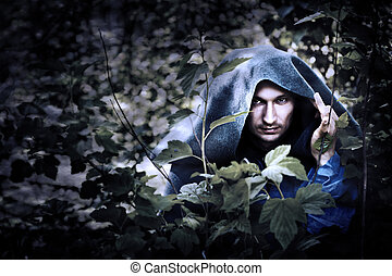 Mystery man in raincoat with hood - Mystery man in a...