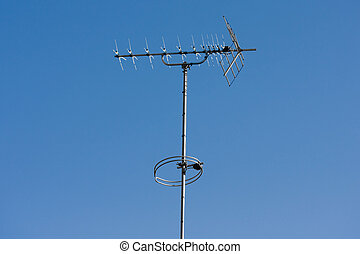 TV aerial with blue sky background - TV aerial on a blue sky...
