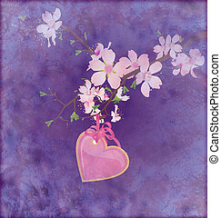 pink heart hanging on the blooming tree brunch on grunge dark blue background