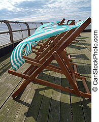 Deckchairs billowing in the wind